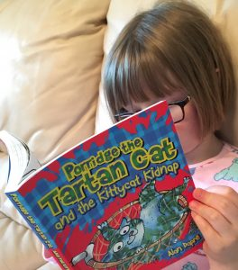 girl reading kittycat kidnap by alan dapre